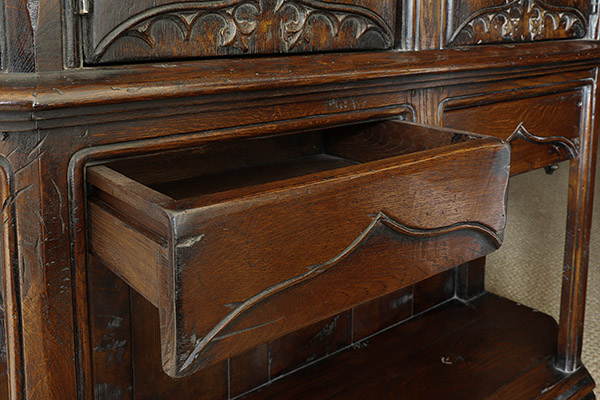 16th century style oak livery cupboard drawer detail.