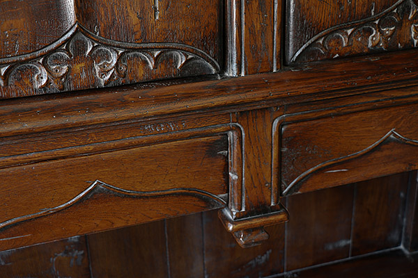 16th century style oak livery cupboard frame detail.