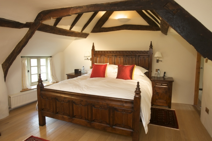 Bespoke design and build of a carved Gothic style oak bed
