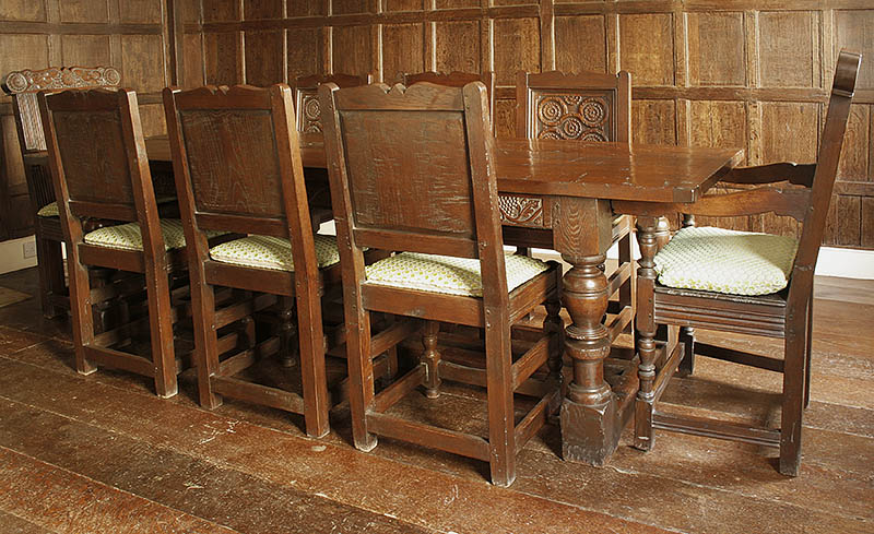 17th century style carved oak dining table, side chairs and armchairs
