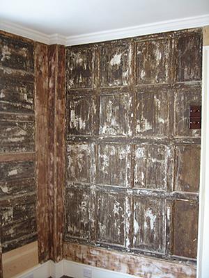 Tudor oak panelling prior to restoration