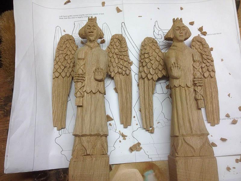 Oak angels part carved for chapel bed