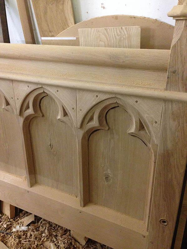 Tracery oak footboard panels in the making
