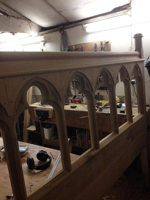 Oak open tracery headboard of chapel bed, in the making