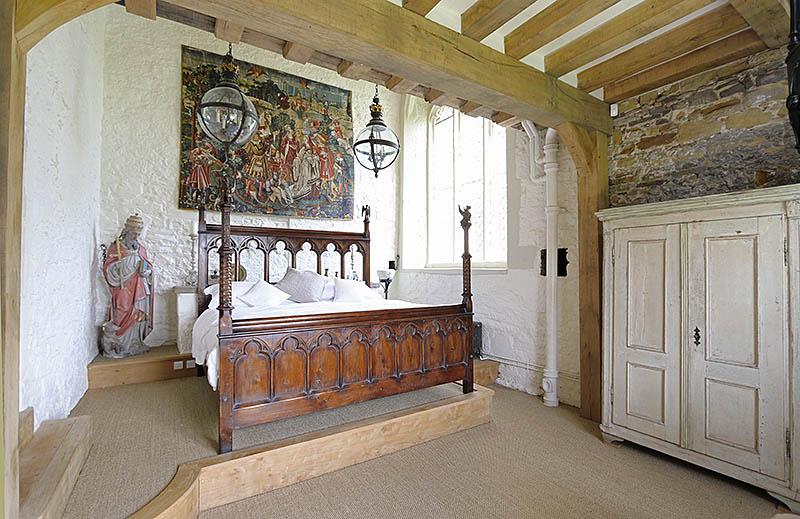 The finished bespoke designed carved oak Medieval style chapel bed