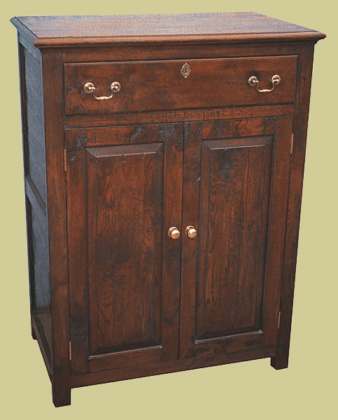 Oak cupboard with drawer above