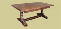 Heavy oak extending pedestal dining table, in period style, shown here in closed format.