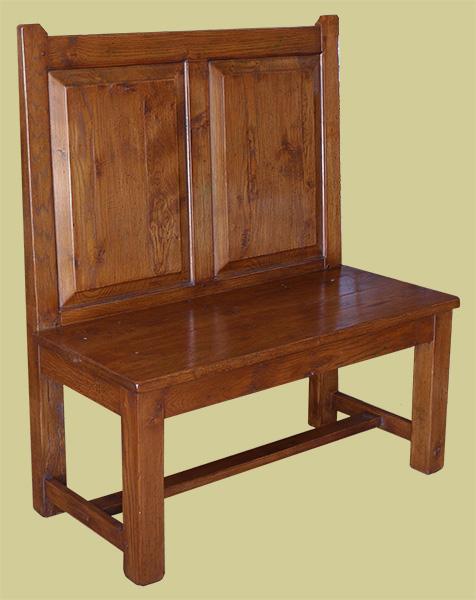 Simple straight back panelled oak hall settle.