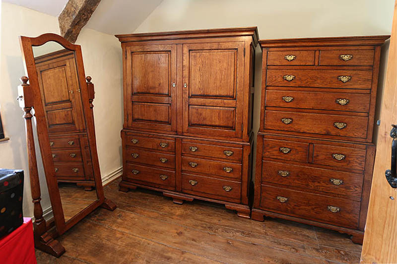 Oak linen press and chest on chest, fully installed in dressing room of Oxfordshire cottage