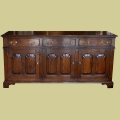 Three drawer, three door early oak style closed dresser base.