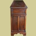 Panelled end of early oak style 3-drawer, 3-door, oak dresser base.