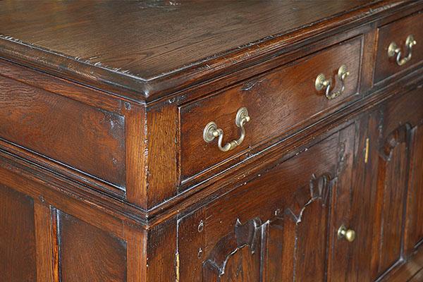 Early oak style closed dresser base, corner detail.
