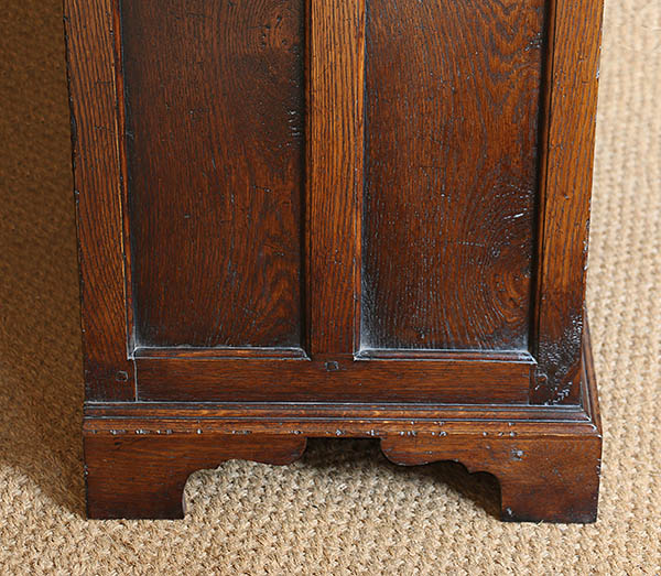 Plinth detail on the panelled end of our early oak style oak closed dresser base.