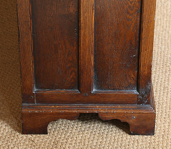 Plinth detail on panelled end of early oak style dresser