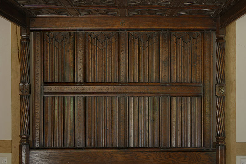 Early 16th century Tudor style hand carved linenfold panels on four poster bed