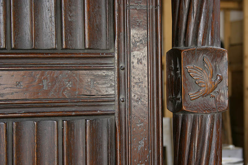 Hand carved post detail on early 16th century Tudor style oak four poster bed