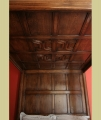 Oak panelled tester ceiling of 16th century Tudor style true 4-poster bed.