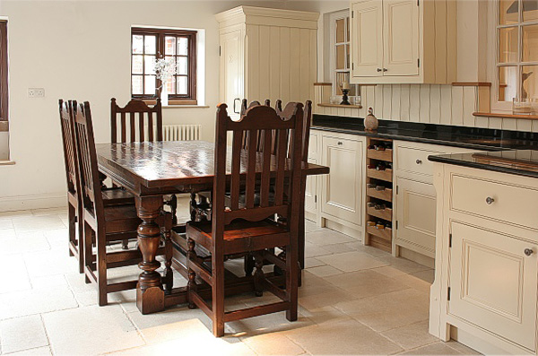 Period style oak extendable dining table and chairs, in hand painted kitchen.