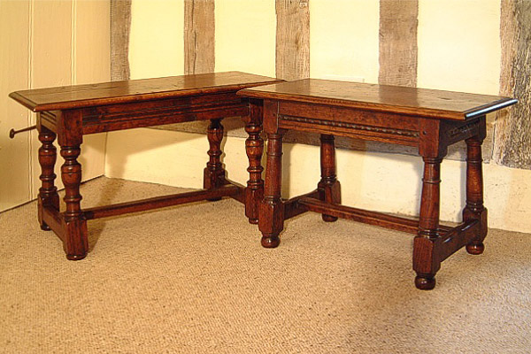 Small 17th century period style oak benches, in timber framed room.