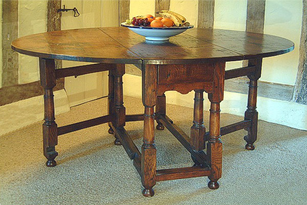 Small 18th century style oak gateleg table, in period room setting