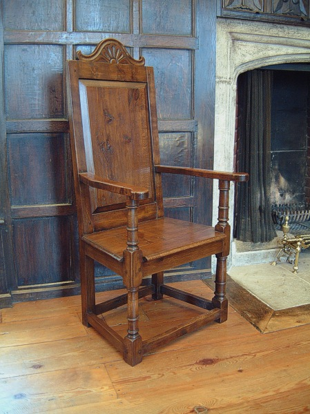 Carved cresting rail oak armchairs in the Great Hall of National Trust