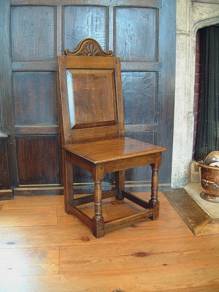 Carved oak side chair in National Trust house