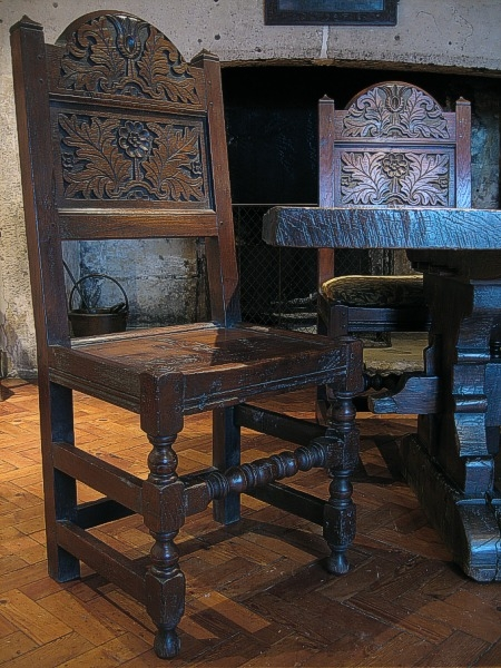 Carved oak dining chairs in Gloucestershire manor house