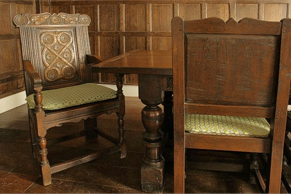 Carved 17th century style armchair in Tudor panelled room