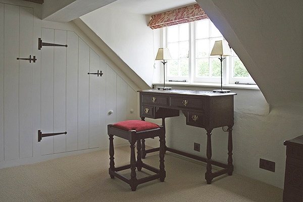 Oak dressing table & stool in country cottage