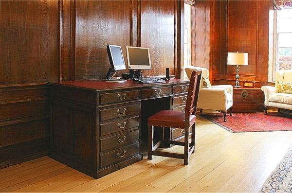 Handmade oak pedestal desk & leather chair in panelled room