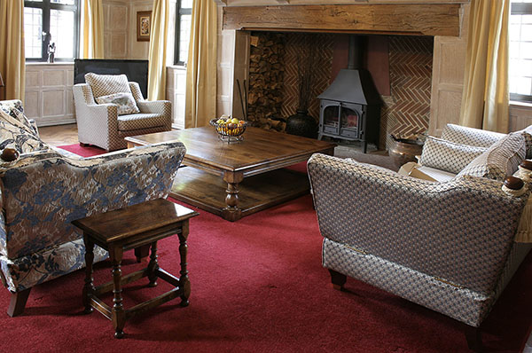 Large square oak coffee table and 17th century style joined stool, in sitting room of beautiful 1930