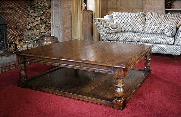 Large coffee table in limewashed oak panelled sitting room