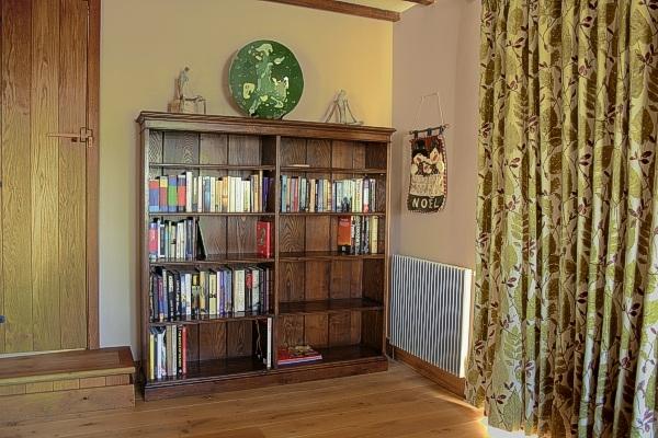 Bespoke double width oak bookshelves in Sussex country house