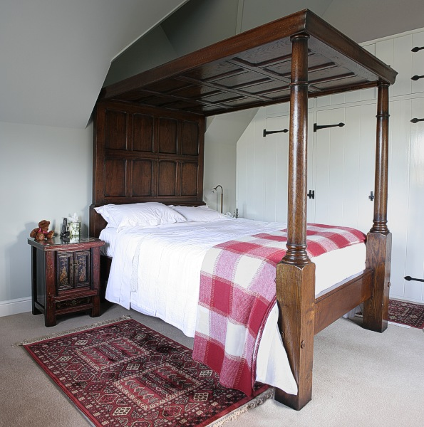 Specially commissioned oak four poster panelled bed, in Surrey cottage.