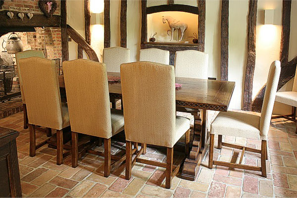 Fully upholstered oak dining chairs in timber framed house.