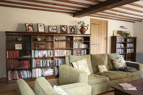 Quad length bespoke oak bookcase in Sussex country house