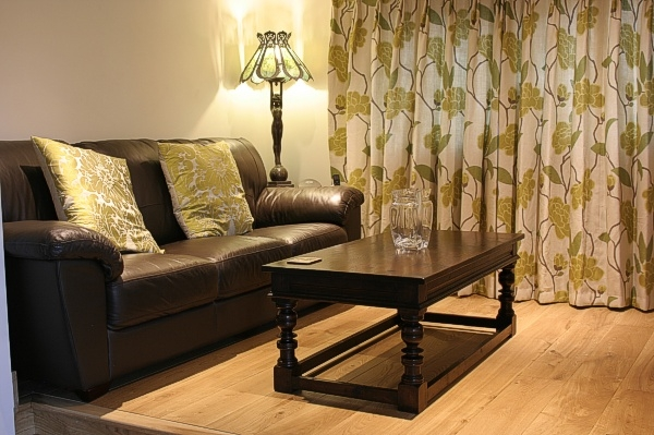 Period style dark oak coffee table in country house snug