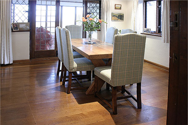Oak fully upholstered dining chairs in early 20th century built traditional Sussex style house.