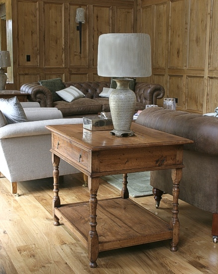 Oak lamp table with concealed wiring in panelled room