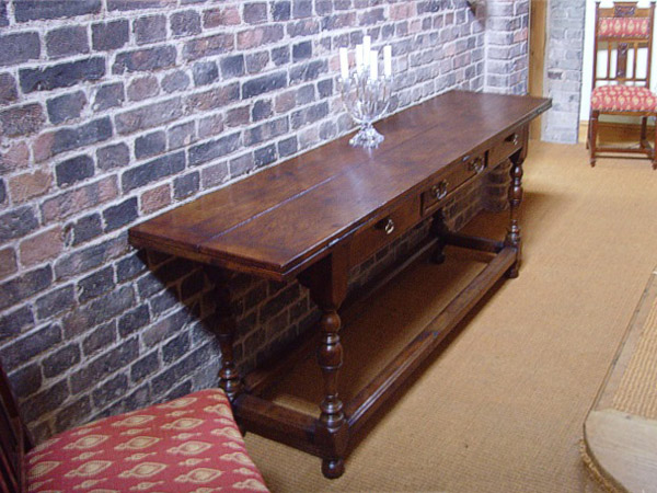 Oak folding side table, in the hallway of our clients Stoke on Trent house. Occasionally also used as a dining table.