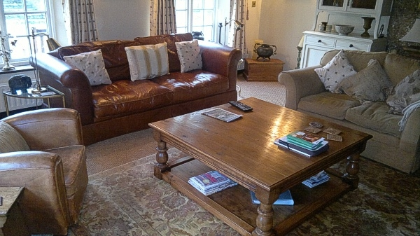 Large oak potboard coffee table in cosy cottage sitting room