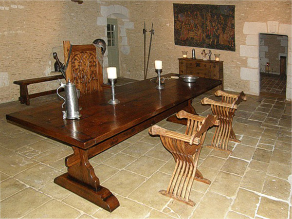 Medieval style oak trestle table, in old French property.