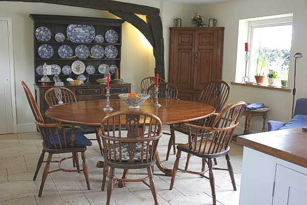 Oval top cherry dining table, in the kitchen/dining room of our clients West Sussex village home.