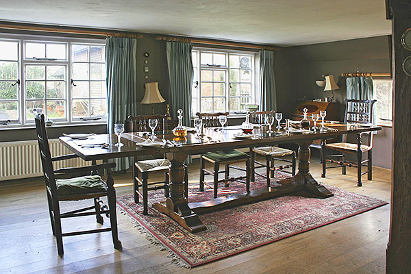 Extended period style oak dining table in traditional Sussex cottage.