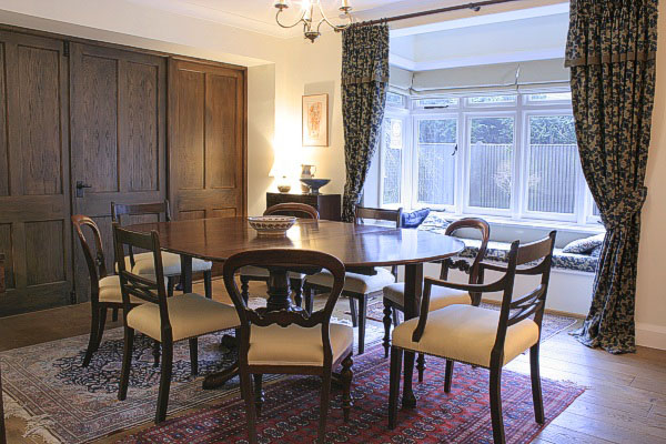 Extending pedestal dining table, colour matched to our clients mahogany chairs, and shown here in the traditionally decorated dining room of their West Sussex country home.