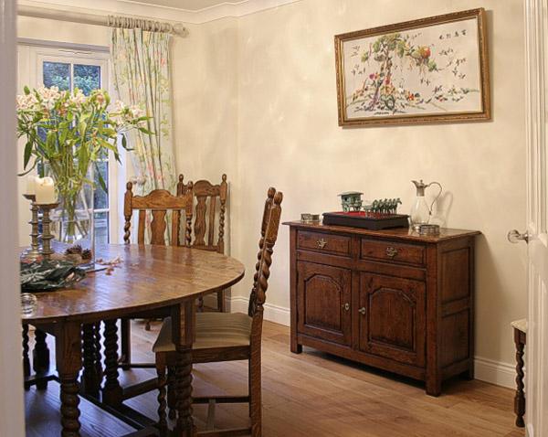 Small oak sideboard in dining room.