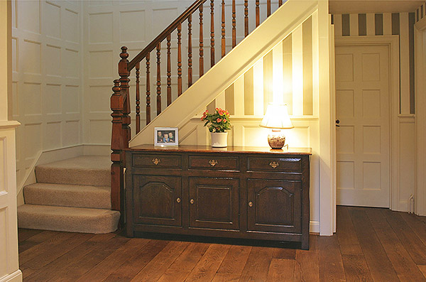 Oak 3-drawer dresser base in hallway of Edwardian house.