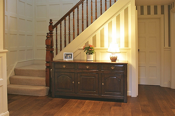 C18th style oak dresser base in hallway of Edwardian house