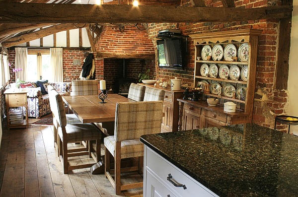 Oak trestle table and upholstered chairs in historic house