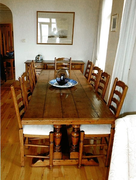 Twin pedestal oak dining table & upholstered ladderbacks